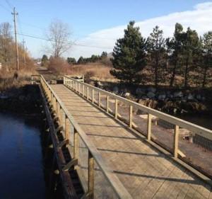 A long wooden bridge was built over the Saugus River.