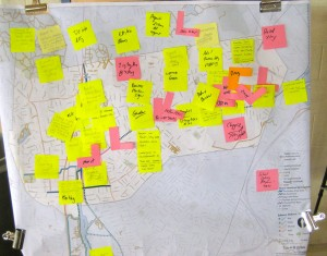 Yellow and pink post-it notes placed over a map of the trail.
