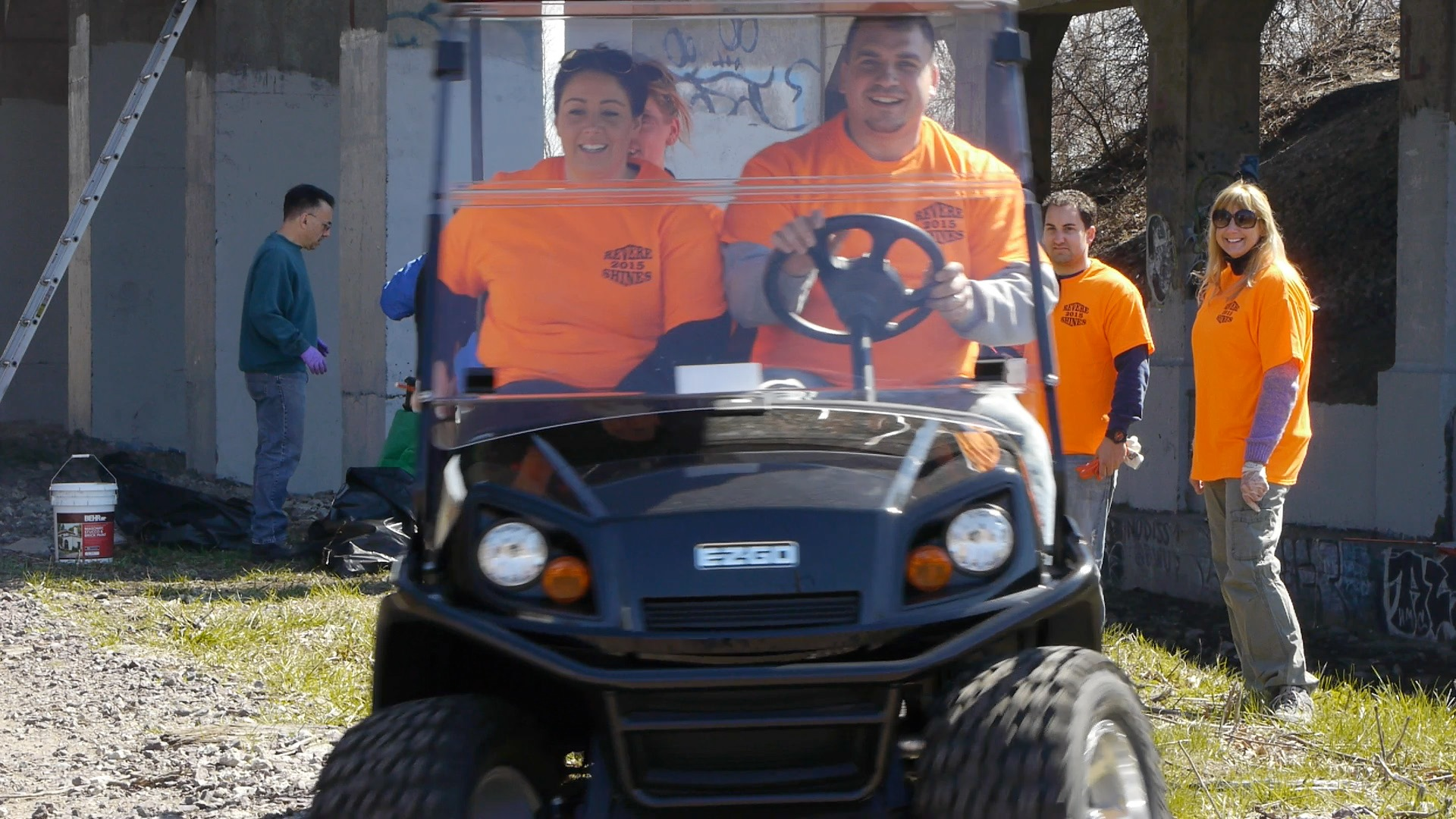 Revere volunteers in a golf cart at last year's clean up event in Revere.