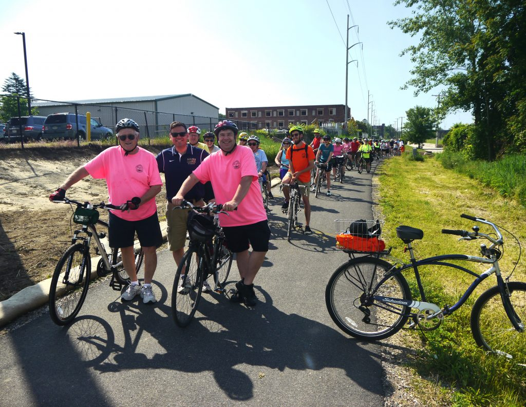 Bicyclists line up along the trail at the beginning of the ride.