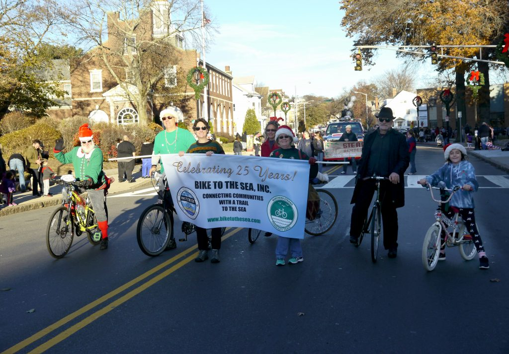 Bike to the Sea members march in Malden's holiday parade.