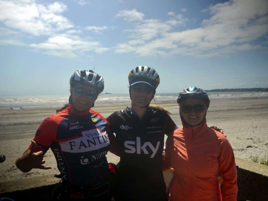 Three women pose for a photo at Nahant Beach.