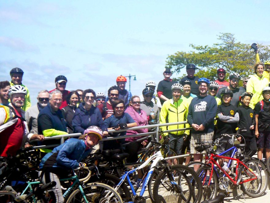 Bicyclists pose for photo at Nahant Beach