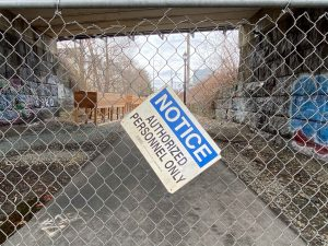 "A sign on a chainlink fence says ""Authorized Personnel Only"""