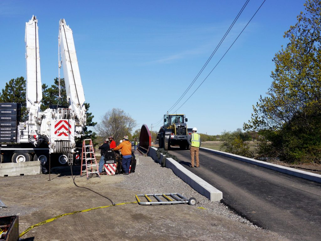 Workers near newly dropped bridge in Saugus along the community trail.